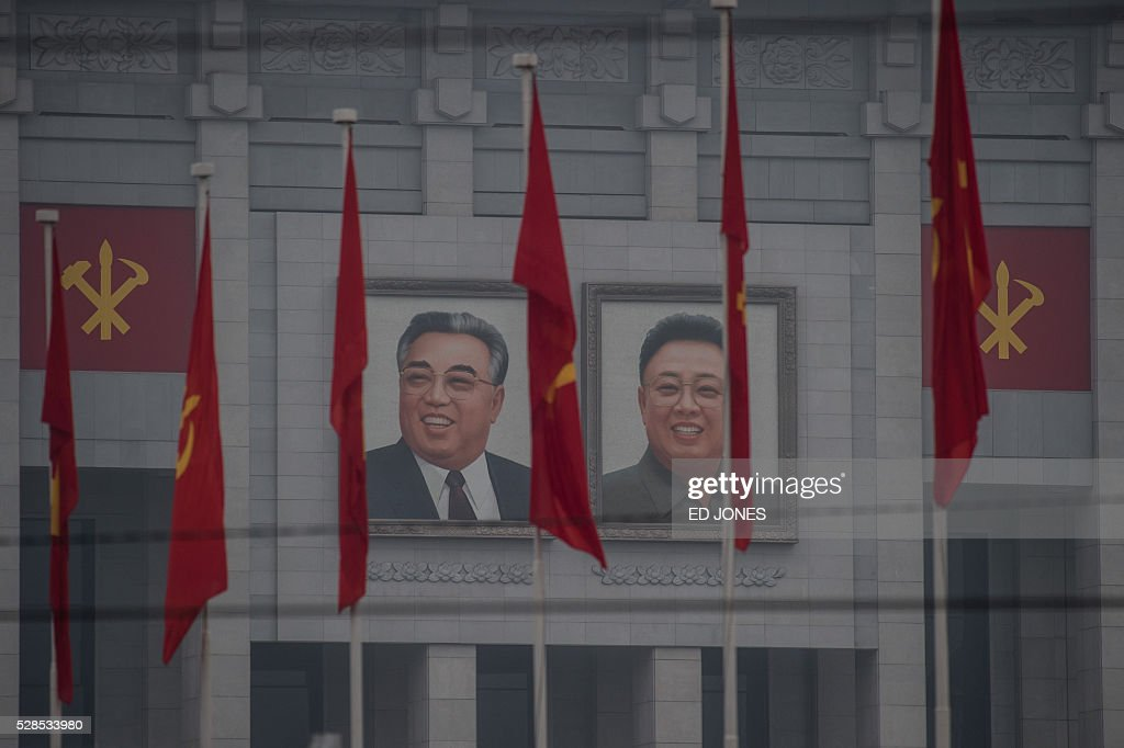 A general view shows portraits of late North Korean leaders Kim Il-Sung (L) and Kim Jong-Il (R) on the 'April 25 Palace', the venue of the 7th Workers Party Congress in Pyongyang on May 6, 2016. North Korea on May 6 kicked off its biggest political show for a generation, aimed at cementing the absolute rule of leader Kim Jong-Un and shadowed by the possibility of an imminent nuclear test. / AFP / Ed Jones