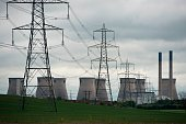 A general view shows pylons and Ferrybridge C power station owned by energy company SSE which is set to stop generating and close in March 2016 near...