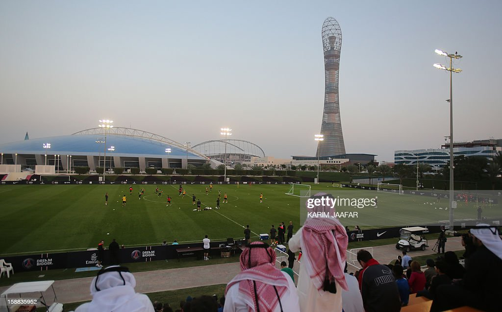 A general view shows Qataris watching Paris Saint-Germain football team training at the Aspire Academy of Sports Excellence in the Qatari capital Doha on December 31, 2012. PSG is in Qatar for a week-long training camp before the resumption of the French Ligue 1 after the winter break. AFP PHOTO / AL-WATAN DOHA / KARIM JAAFAR == QATAR OUT ==