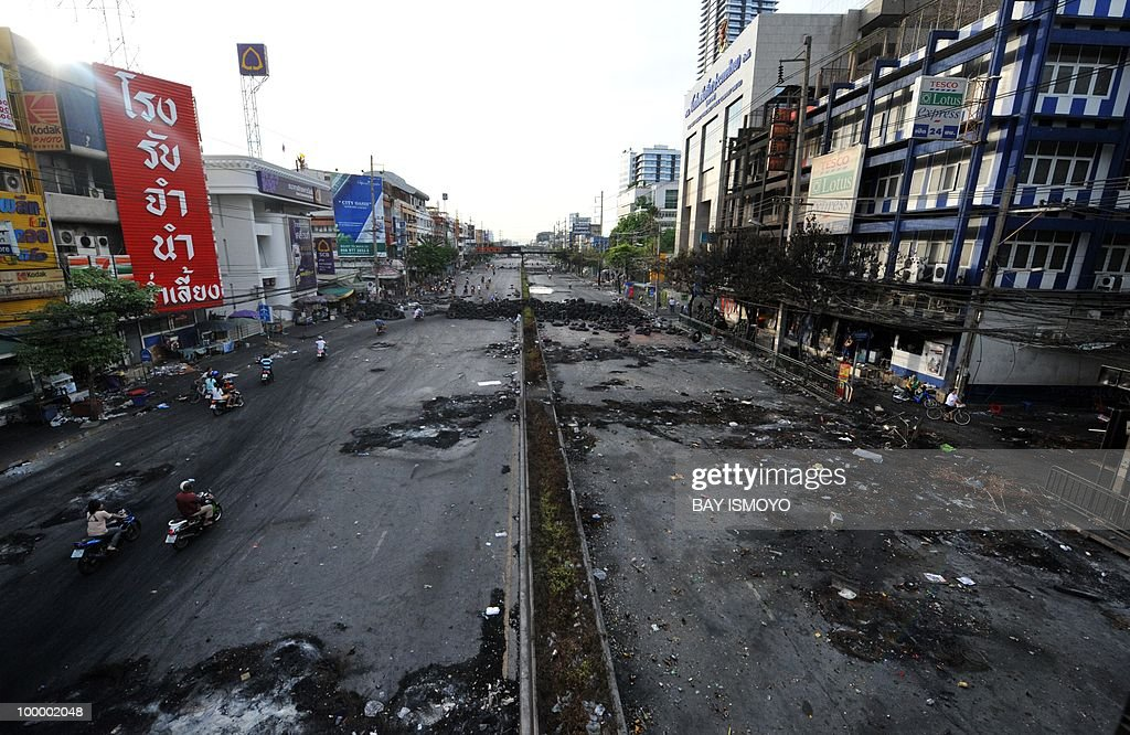 A general view shows Rama IV boulevard in downtown Bangkok on May 20, 2010 where traces of burnt barricades and tyres remain. Several people were killed on May 19, 2010 in clashes at a temple declared a 'safe zone' in the heart of a Thai anti-government rally site that was shut down in a military offensive, police said Thursday.