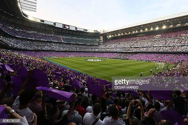 A general view shows Real Madrid fans display purple and white papers before the UEFA Champions League semifinal second leg football match Real...