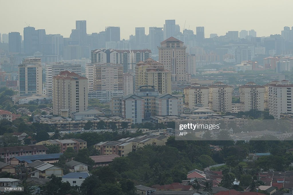 A general view shows residential and commercial buildings as haze clears in Ampang, the suburbs of Kuala Lumpur on June 27, 2013. Malaysia on June 27 stepped up pressure on Indonesia to do more to stop outbreaks of smog after fires on Sumatra island sparked Southeast Asia's worst air pollution crisis for years. AFP PHOTO / MOHD RASFAN