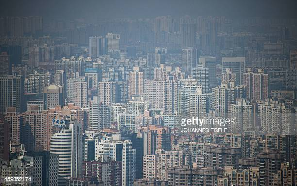 A general view shows residential buildings on a hazy day in Shanghai on November 21 2014 Growth in foreign investment into China slowed in October...