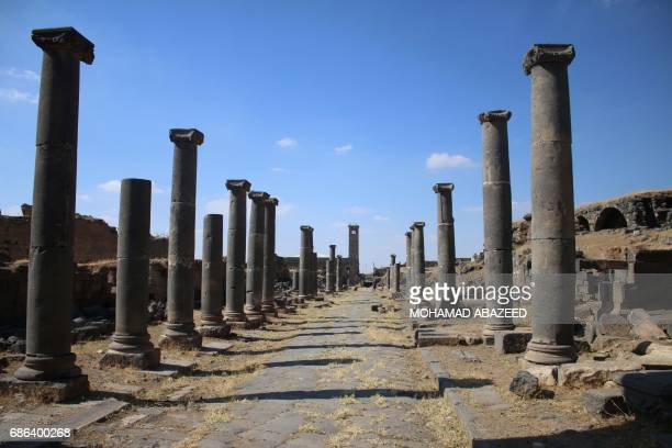 A general view shows Roman columns in the ancient city of Bosra alSham which is listed as a UNESCO World heritage site in the southern Syrian...