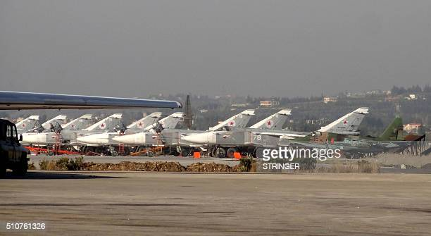 A general view shows Russian fighter jets on the tarmac at the Russian Hmeimim military base in Latakia province in the northwest of Syria on...