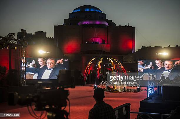 A general view shows screens displaying photos of late Egyptian actor Mahmud Abdul Aziz in the Cairo opera House during the Closing ceremony of the...
