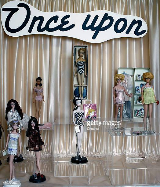 A general view shows several Barbie dolls to display during the exhibition 'Barbie retro chic' at the 'Musee de la poupee' on February 13 in Paris...