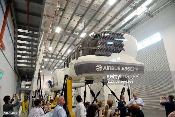 A general view shows simulators of the A350 XWB during a media tour of the Airbus Asia Training Centre in Singapore on June 20 2017 Airbus Asia...