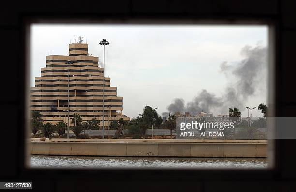A general view shows smoke rising from buildings in the centre of Libya's eastern coastal city of Benghazi on October 20 2015 following shelling the...