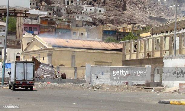 A general view shows smoke rising out of the Roman Catholic church of St Joseph in Yemen's second city of Aden after unidentified assailants set...