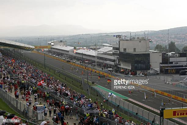 A general view shows spectators watching the Hungarian Formula One Grand Prix from a grandstand at the Hungaroring circuit in Budapest on July 27...
