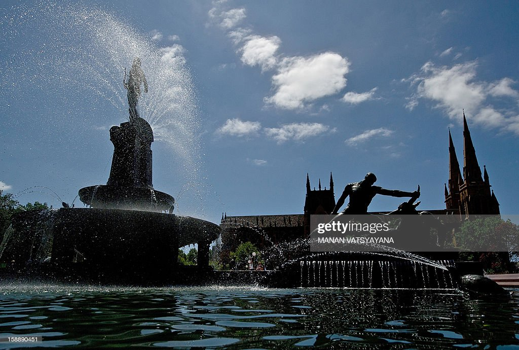 A general view shows the Archibald fountain (L) with St Mary's Cathedral (back R) in Sydney's Hyde Park on January 3, 2013. The fountain was built in 1932 by French sculptor François-Léon Sicard with the intention of commemorating the association between Australia and France during World War One.