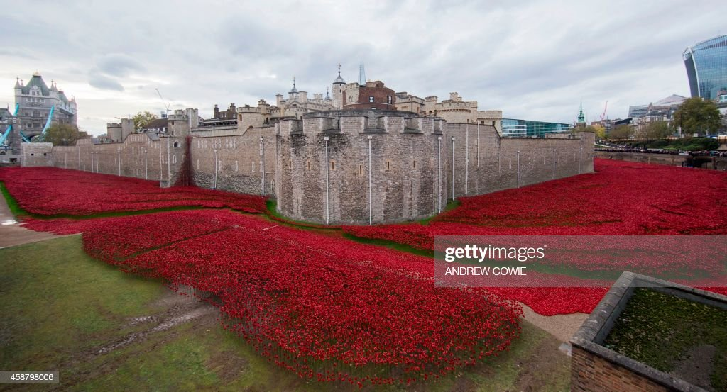 A general view shows the 'Blood Swept Lands and Seas of Red' installation of ceramic poppies by artist Paul Cummins and theatre stage designer Tom...