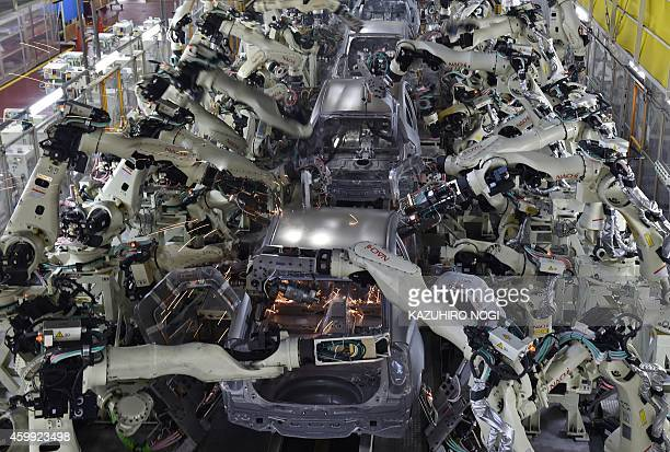 A general view shows the body welding workshop which uses automated welding machine robots that assemble automobile bodies called white body at...
