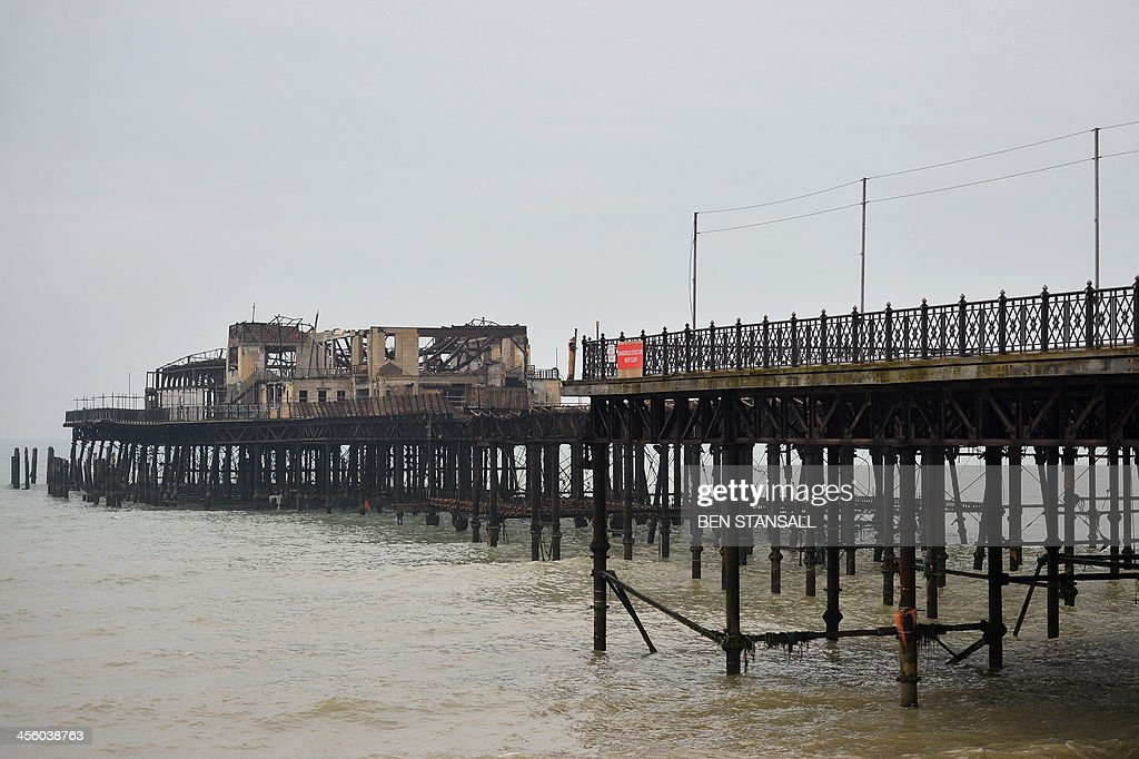 A general view shows the burnt-out remains of Hastings Pier in Hastings, southern England, on December 13, 2013 ahead of the start of a multi-million pound regeneration project. Hastings Pier was originally constructed in opulent style in the late 19th century seeing its heyday in the 1930s and hosting music concerts by major artists including The Rolling Stones in the 1960s and 70s. After undergoing various additions and re-construction to repair storm and fire damage throughout the 20th century the Victorian pier finally suffered a devastating fire in 2010 which destroyed much of the superstructure leaving just a burnt out shell. Following a Heritage Lottery Fund (HLF) grant and money from other funds a 14 million GBP regeneration project is set to begin work on January 6, 2014.