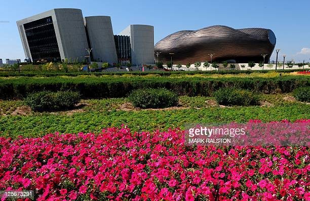 A general view shows the City Library and the Ordos Museum building in the city centre of Ordos Inner Mongolia on September 12 2011 The city which is...