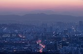 A general view shows the city skyline of northern Seoul looking east before sunrise on January 28 2015 In January South Korea sees an average of some...
