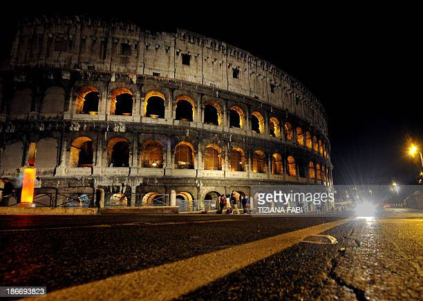A general view shows the Coliseum at night during 'The Colosseum under the moon' tour on November 2 2013 in Rome AFP PHOTO / TIZIANA FABI