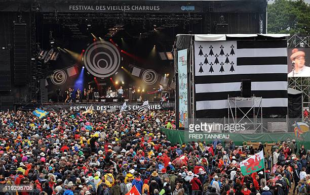 A general view shows the crowd during the show of French singer Ben l'Oncle Soul at the 20th edition of the Vieilles Charrues Music Festival on July...