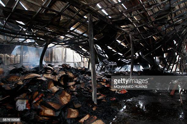 A general view shows the damage at the AlAqel food factory that makes potato chips in Yemen's rebelheld capital Sanaa after it was hit by a Saudiled...