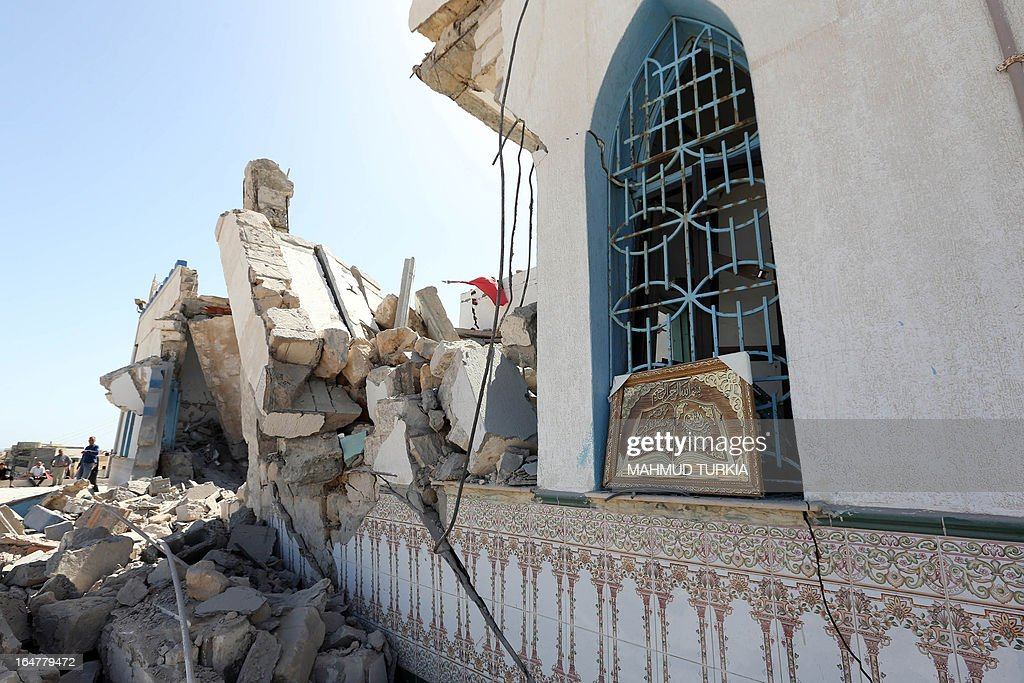 A general view shows the debris and rubble of a damaged Sufi shrine in the neighbourhood of Tajoura, on the outskirts of Tripoli, after it was attacked during the early hours of the morning by unknown individuals on March 28, 2013. Unknown attackers planted and set off an explosive device, partially destroying the mausoleum of Sidi Mohamed Landoulsi, a 15th Century Sufi Theologist.