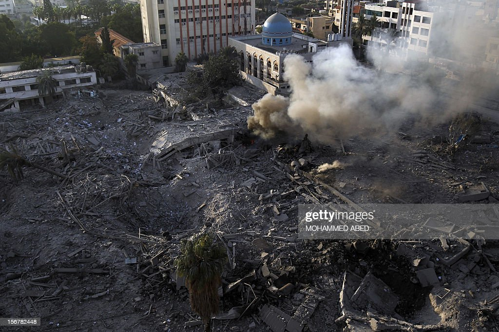 A general view shows the destroyed compound of the internal security ministry in Gaza City after it was targeted by Israeli air strike overnight on November 21, 2012. Fighting raged on both sides of Gaza's borders Wednesday despite intensified efforts across the region to thrash out a truce to end a week of violence that has cost 136 Palestinian and five Israeli lives.