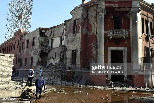 A general view shows the destroyed facade of the Italian consulate building following a powerful bomb explosion killing one person in the capital...