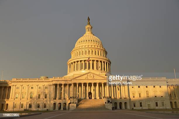 A general view shows the East Front of the US Capitol as the sun rises hours before the 57th Presidential Inauguration on January 21 2013 US...