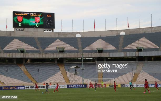 A general view shows the empty stadium during the Asian Champions League football match between Qatar's Lekhwiya SC and Iran's Persepolis FC at the...