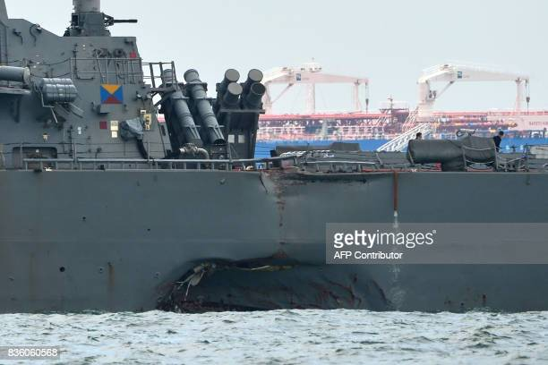 A general view shows the guidedmissile destroyer USS John S McCain with a hole on its left portside after a collision with oil tanker outside Changi...