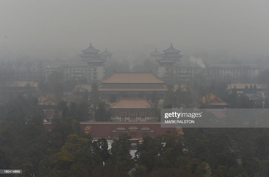 A general view shows the Guotai Chambers building from the historic Jingshan Park as smog continues to shroud Beijing on January 31, 2013. Doctors in Beijing said on January 31 that hospital admissions for respiratory complaints rose in recent days during the latest bout of air pollution to cover northern China. AFP PHOTO/Mark RALSTON