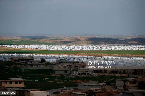 TOPSHOT A general view shows the Hasan Sham camp on March 26 in the village of Hasan Sham some 30 kilometres east of Mosul GHARABLI