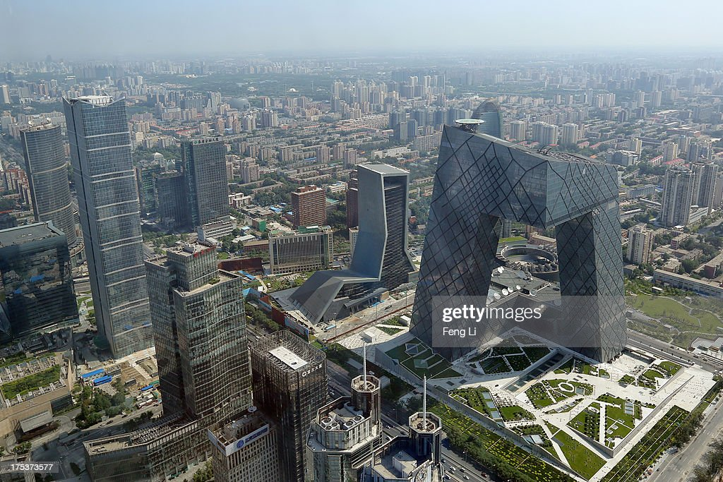 A general view shows the headquarter of China Central Television amid the Beijing skyline at central business district on August 3 2013 in Beijing...