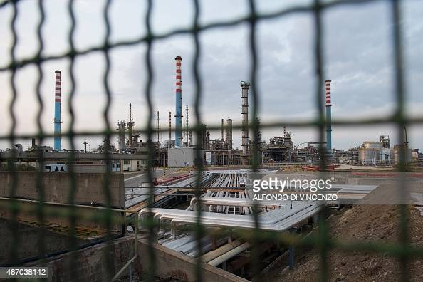 IDE A general view shows the Ilva steel plant through a fence in Taranto on March 18 2015 The site in Taranto in the Puglia region of southern Italy...