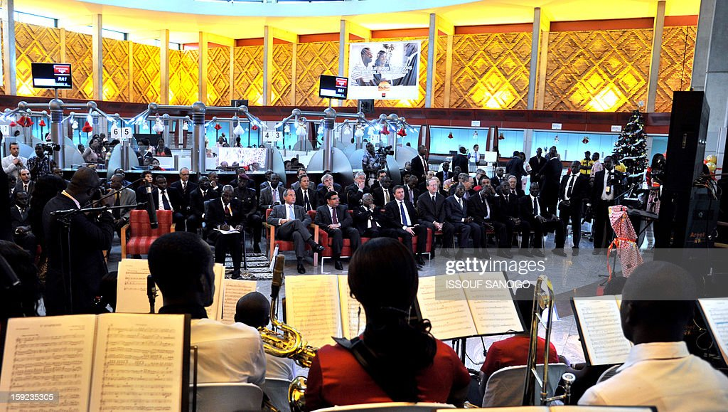 A general view shows the Ivorian prime minister and the chief executive officer of French bank Societe Generale attending on January 10, 2013 events marking the inauguration of the lobby of the Societe Generale de Banque in Ivory Coast at bank headquarters in Abidjan (SGBCI) on the 50th anniversary of the bank in Ivory Coast.