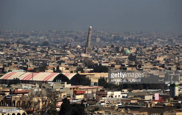TOPSHOT A general view shows the leaning minaret of the Great Mosque of alNuri in Mosul on March 10 as Iraqi forces shell enemy positions during an...