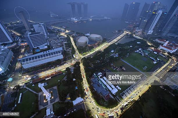A general view shows the lit circuit for the upcoming Formula One Singapore Grand Prix night race on September 11 2014 The Singapore Grand Prix will...