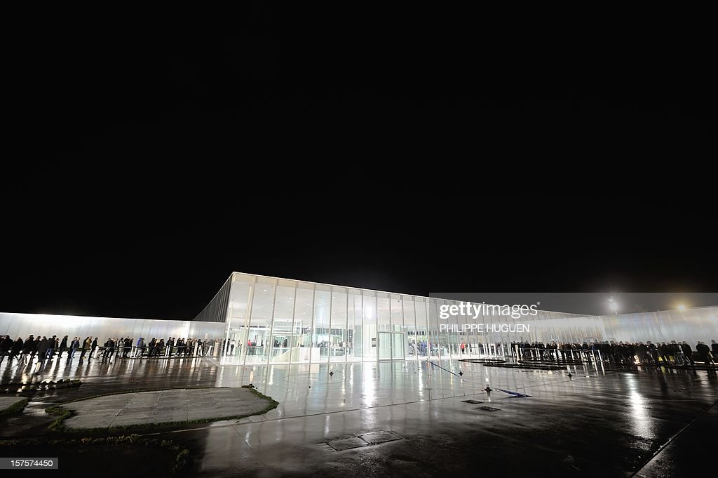 A general view shows the Louvre Museum at night on the first day of its opening to the public on December 4, 2012 in Lens, northern France. The Louvre museum opened a new satellite branch among the slag heaps of a former mining town Tuesday in a bid to bring high culture and visitors to one of France's poorest areas. Greeted by a group of former miners in overalls and hardhats, President Francois Hollande inaugurated today the Japanese-designed glass and polished-aluminium branch of the Louvre in the northern city of Lens. The 150 million euro ($196 million) project was 60 percent financed by regional authorities in the Nord-Pas-De-Calais region, on the English Channel and the border with Belgium.