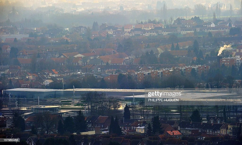 A general view shows the Louvre-Lens museum on December 8, 2012 in Lens, northern France. The Louvre museum opened a new satellite branch among the slag heaps of a former mining town on Dcember 4, 2012 in a bid to bring high culture and visitors to one of France's poorest areas. AFP PHOTO PHILIPPE HUGUEN