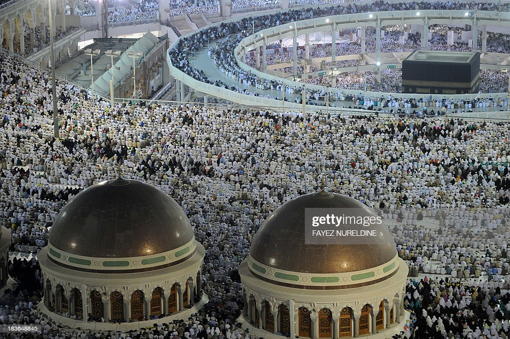A general view shows the new raised walkway installed around the Kaaba (top-R) so people with disabilities can circle around the holy shrine, as pilgrims perform evening prayers in Mecca's Grand Mosque on October 8, 2013. More than two million Muslims have arrived in the holy city for the annual hajj pilgrimage which begins on October 13 amid concerns over the deadly MERS coronavirus. AFP PHOTO/FAYEZ NURELDINE