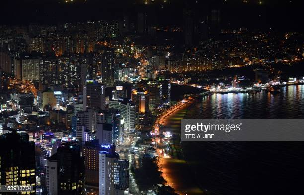 A general view shows the night skyline of Haeunde beach area in Busan on October 11 2012 South Korea's central bank cut its key interest rate by 25...