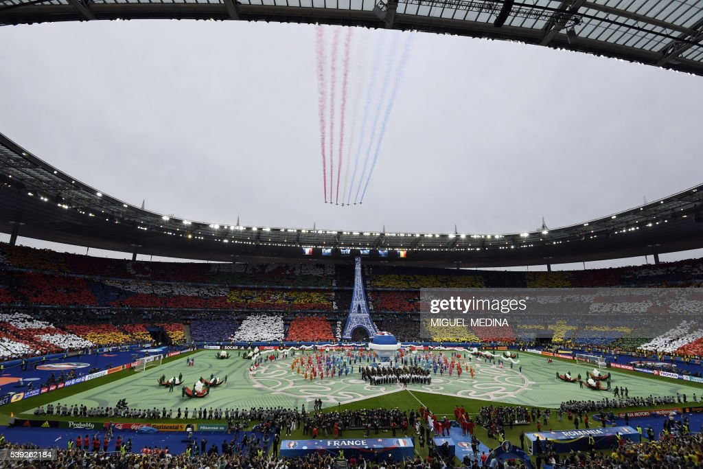 TOPSHOT - A general view shows the opening ceremony prior to the kick off for the Euro 2016 group A football match between France and Romania at Stade de France, in Saint-Denis, north of Paris, on June 10, 2016. /