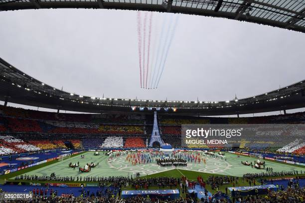 TOPSHOT A general view shows the opening ceremony prior to the kick off for the Euro 2016 group A football match between France and Romania at Stade...