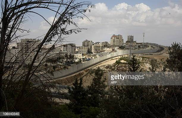 A general view shows the Palestinian Shuafat refugee camp behind Israel�s controversial separation barrier in east Jerusalem on October 9 2010 AFP...