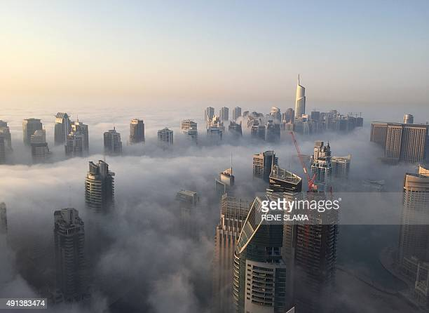 A general view shows the part of the skyline of Dubai covered in an early morning fog on October 5 2015 AFP PHOTO / RENE SLAMA