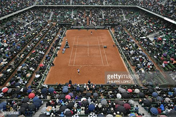 A general view shows the Philippe Chatrier court as France's Richard Gasquet returns the ball to Japan's Kei Nishikori during their men's fourth...