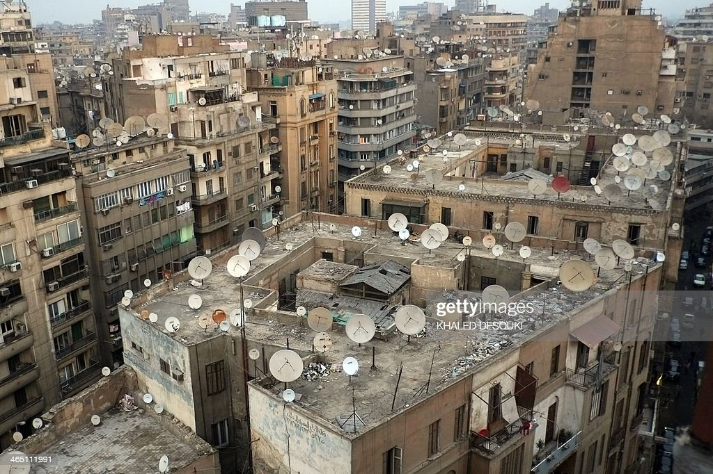 A general view shows the rooftops of buildings in Cairo on January 9 2014 The growth of people living on the rooftops in Africa's biggest metropolis...