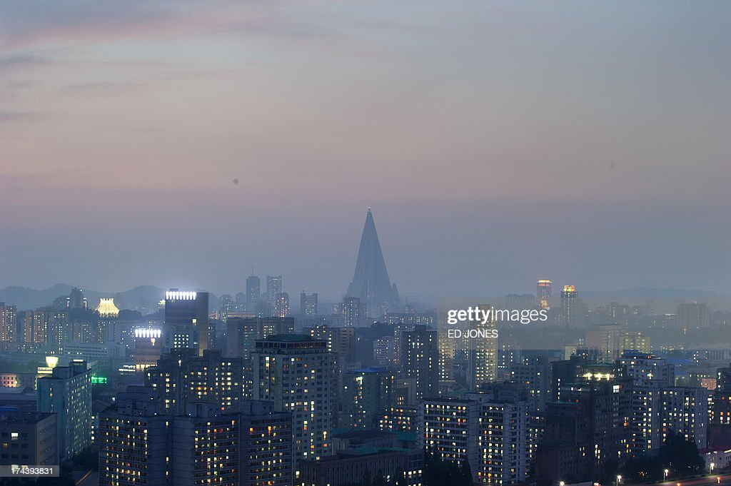 A general view shows the Ryugyong hotel (back C) and the Pyongyang skyline on July 25, 2013. North Korea is preparing to mark the 60th anniversary of the end of the Korean War which ran from 1950 to 1953, with a series of performances, festivals, and cultural events culminating with a large military parade taking place on July 27. AFP PHOTO / Ed Jones