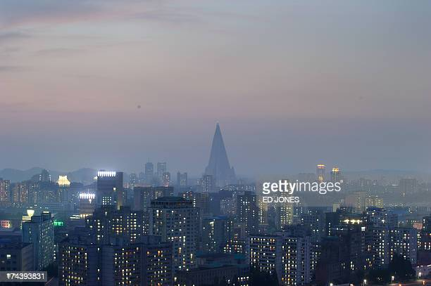 A general view shows the Ryugyong hotel and the Pyongyang skyline on July 25 2013 North Korea is preparing to mark the 60th anniversary of the end of...