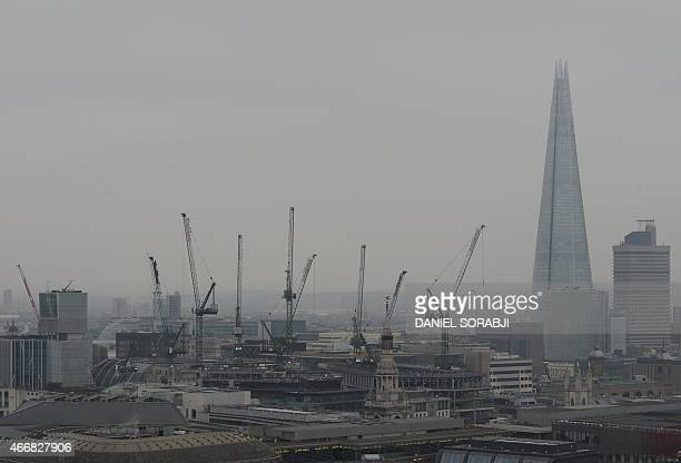 A general view shows The Shard skyscraper in central London on March 19 2015 A toxic air pollution cloud blew over Britain on Thursday causing...